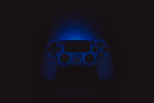 silhouette photography of Sony DualShock 4
